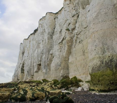 View of a steeply sloping cliff formed from soft chalk