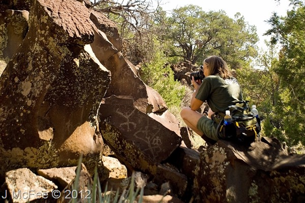 Gaelyn taking photos at Nampaweap petroglyphs