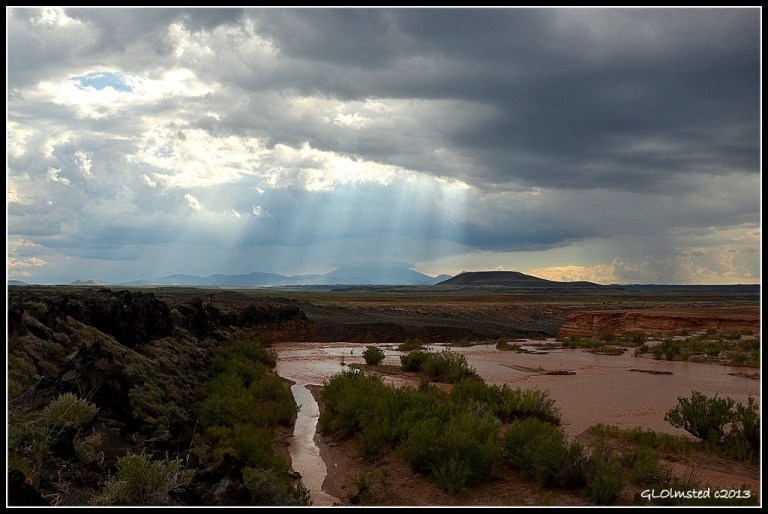 Little Colorado River at Grand Falls and sun rays over Mt Humphreys Navajo Reservation Arizona