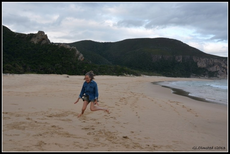 Gaelyn trying to jump on beach at Tsitsikamma National Park Nature's Valley South Africa