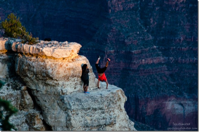 Idiot visitor doing handstand on ledge from Lodge North Rim Grand Canyon National Park Arizona
