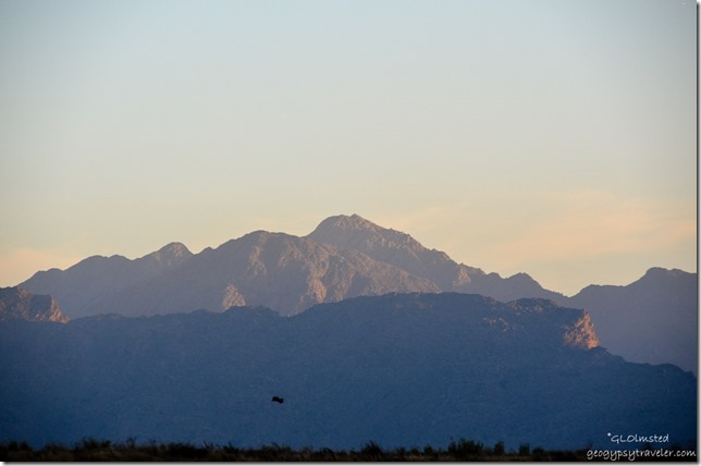 Last light on mountains from dam at Rodene Farm Cottages Ceres South Africa