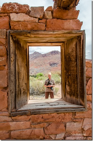 Diane through window of 1910 Stone building Lees Ferry Glen Canyon National Recreation Area Arizona