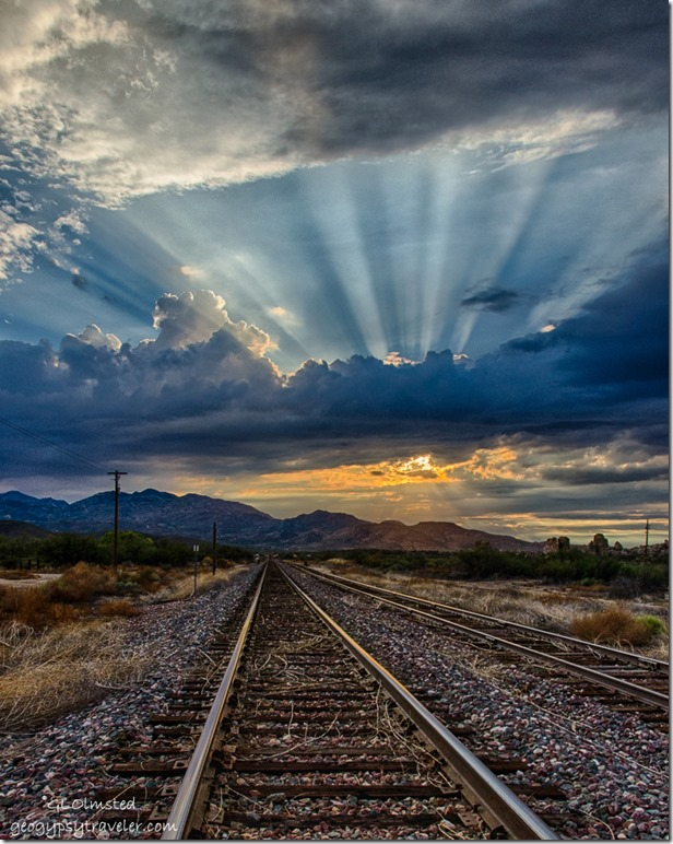 Crepuscular rays RR tracks sunset Kirkland Arizona