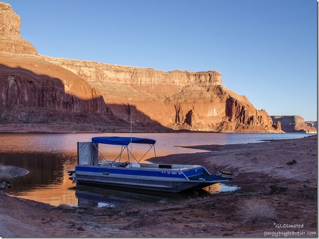 Morning light & boat from camp Dungeon Canyon Lake Powell Glen Canyon National Recreation Area Utah