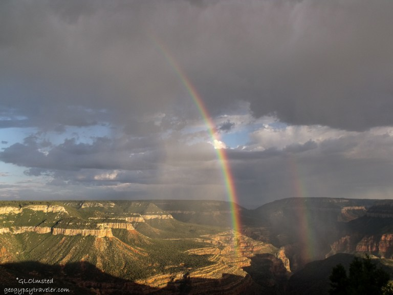 View South of rainbows over canyon from Crazy Jug Point FS292 Kaibab National Forest Arizona