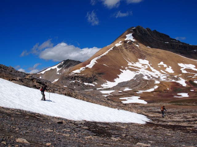 Youngest GeoKid crosses packed snow as we begin our descent from the ridge