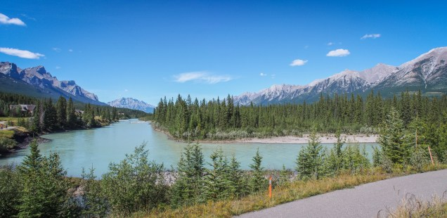 Looking west, upstream along the Bow River, from the pathway near Prospect subdivision. Cascade Mountain, inside Banff National Park, is aligned with the river channel.