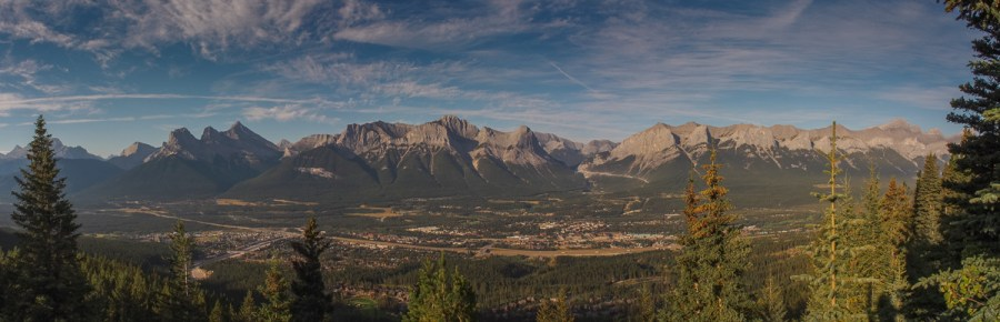 Looking across the Bow Valley from the Mount Lady MacDonald teahouse. Canmore is at the valley bottom and the Three Sisters, Grassi, Ha Ling and Mount Rundle from left to right.