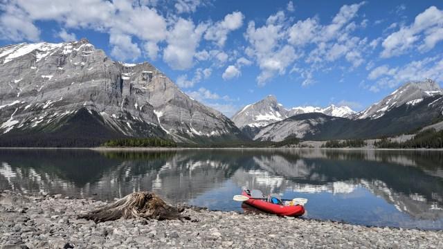 red kayak on lakeshore