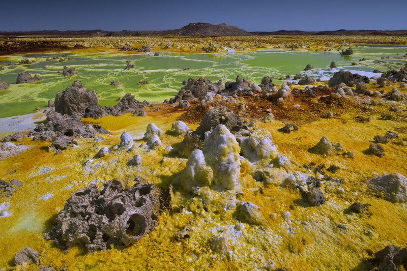 Going up through a thick salt dome the waters heated by the Dallol volcano become hyperacid and load of minerals It erects at surface these bright terraces of geyserite. Ethiopia