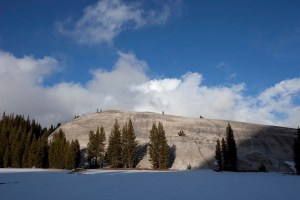 Roche moutonnée, a bare outcrop of rock shaped by glacial erosion.