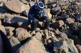 Nicola photographing a site with frost heave