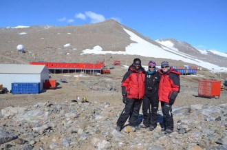 Tebogo, Jenna and Nicola with the buildings of Troll in the background