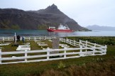 Grytviken cemetery - the home of Sir Sir Ernest Shackleton's grave - with the S.A. Agulhas II in the background