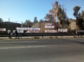The banners of solidarity cover both sides of the national road