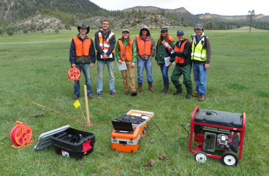 Geophysics students with equipment