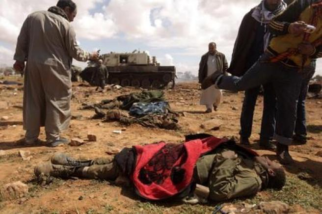 guerra-in-libia-gheddafi-usa-scudi-umani-l-qgaway