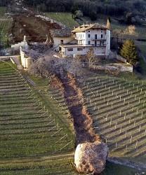 A giant boulder smashes through a barn of an Italian farmhouse