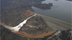 February 12, 2017 image of water flowing over emergency spillway at Oroville Dam in California