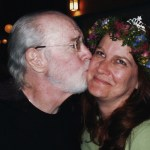 George kissing his daughter, Kelly