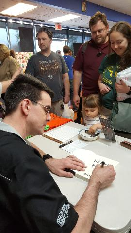 Free Comic Book Day - George G. Moore Signing a Book