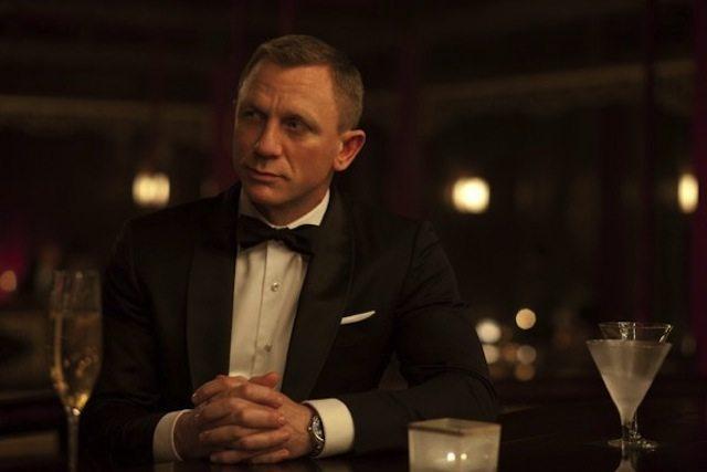 Daniel Craig in a midnight blue, shawl collar tuxedo