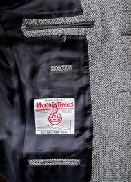 The jacket's left interior with the Harris Tweed trademark.