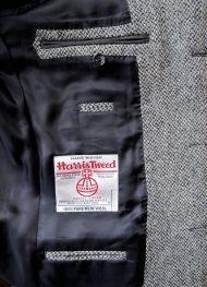 The jacket's left interior with the Harris Tweed trademark.