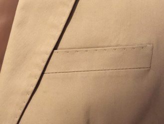 Lapel and breast pocket detail.
