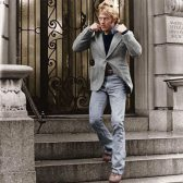 Redford in his herringbone tweed and bootcut jeans.