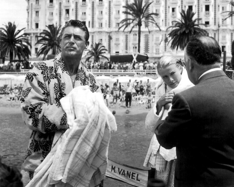 On location with Hitch at the beach in front of the Carlton Hotel. That robe.