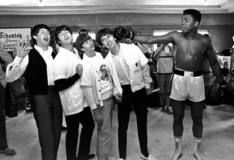 Feb. 18, 1964 - The Beatles, from left, Paul McCartney, John Lennon, Ringo Starr, and George Harrison, take a fake blow from Muhammad Ali while visiting the heavyweight contender at his training camp in Miami Beach, Fla. (AP Photo/File)