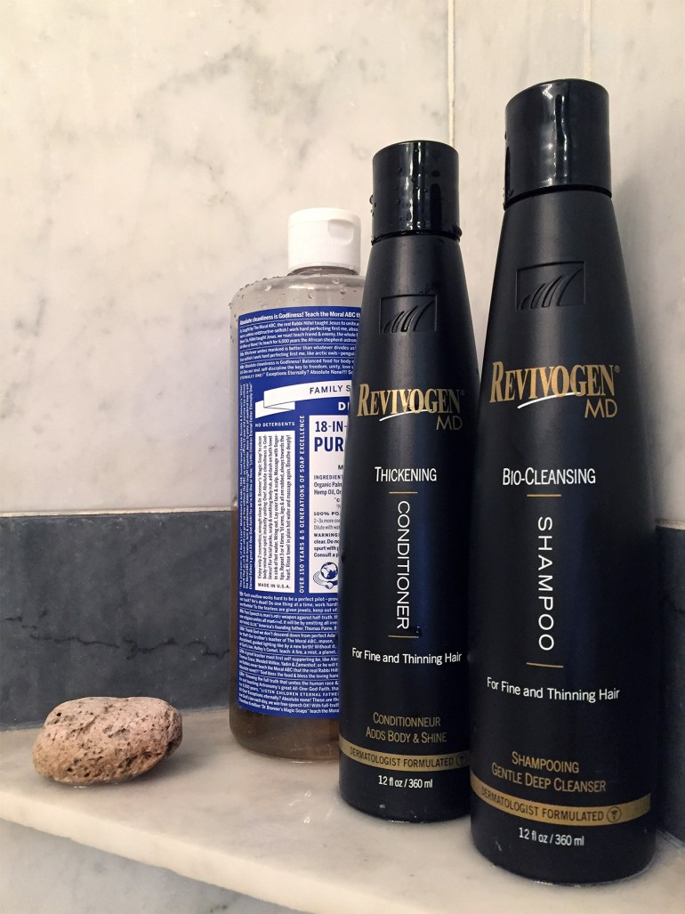 The shelf in my shower: pumice stone, soap, Thickening Conditioner and Bio-Cleansing Shampoo.