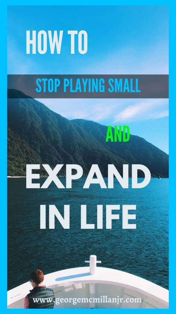 A pinterest image for a blog post of a boat, the ocean, and mountains that says How to Stop Playing Small and Expand in Life