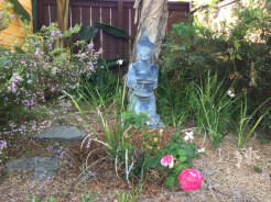 A buddha watches over the back patio.