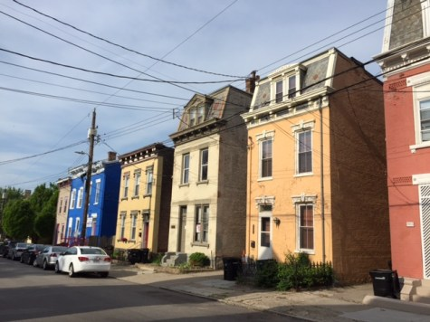 A row of townhouses bring color to Cincinnati's Victor Street.