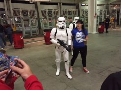 Adults and children alike wanted their pictures taken with storm troopers on Star Wars Night at the ballpark.
