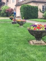 Flower pots and a lawn jockey on NE Alameda Street.
