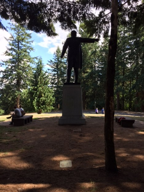 A statue of Harvey Scott, editor of The Oregonian from 1865 until his death in 1910, stands at the top of a path near the summit.