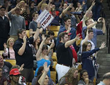 Trump supporters offer a Nazi-like gesture during a rally in support of the Republican presidential candidate.