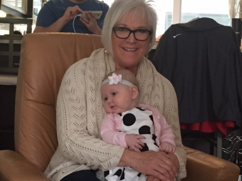 Nonni Lori holds her stylishly dressed granddaughter.
