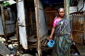 Rubina is using the hanging toilet everyday in molar slum. Rubina has lived here for last three years. Before that she was in village. Her husband got a job in Dhaka so they moved into the slum. The toilet they are currently using is a shared hanging toilet. It is situated 20 metres from their home. Once, in middle of the night, she went to the toilet and someone knocked the toilet door so harshly as if they were going to break the door. She got very scared and nearly fainted by the incident. Since then, she is too scared to use the toilet after 9pm.