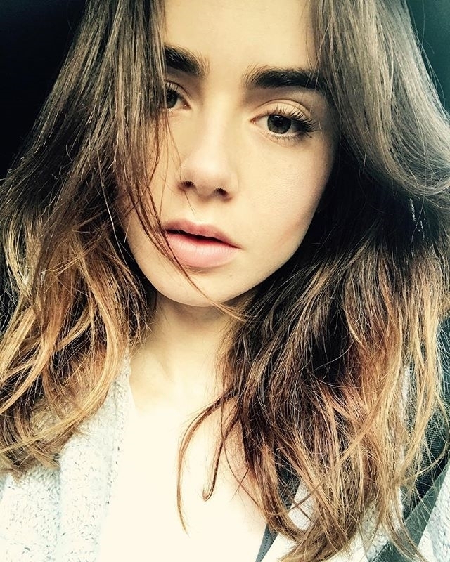 This girl is gorgeous.  regram @lilyjcollins Wrapped for the day. Bedtime is calling my name… #Netflix #actress #lilyCollins #cinema #bushyeyebrows