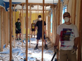 The group ripped out walls in the house they are working on with Habitat for Humanity.