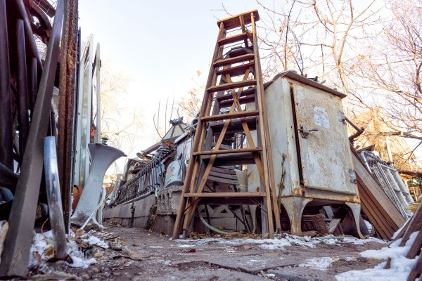 Ladder and ice chest in George's salvage yard
