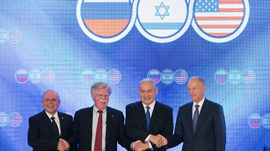 Official photograph of US, Russian, and Israeli officials.