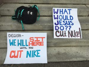 Signs of protest on Healy steps. Photo: Lilah Burke