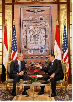 2008 - President Bush and Mubarak pat each other on the back for making life better for all Egyptians, Americans and the Middle East - from White House archives