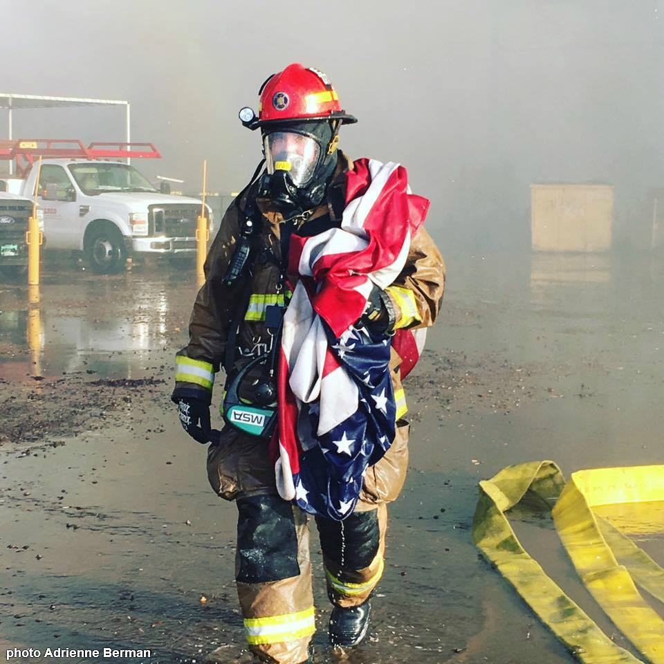 photo of firefighter u0027s american flag rescue has gone viral